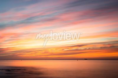 Наклейка Fototapeta: Sunrise over a beach in Cornwall UK